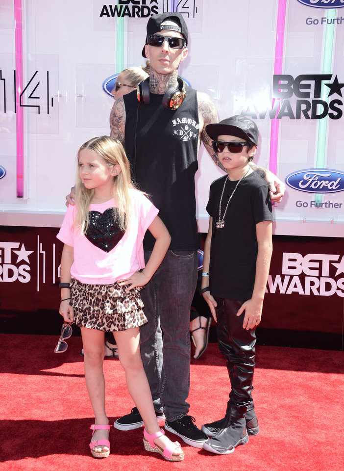 Photo - Travis Barker, center, Alabama Barker, left, and Landon Barker arrive at the BET Awards at the Nokia Theatre on Sunday, June 29, 2014, in Los Angeles. (Photo by Dan Steinberg/Invision/AP)