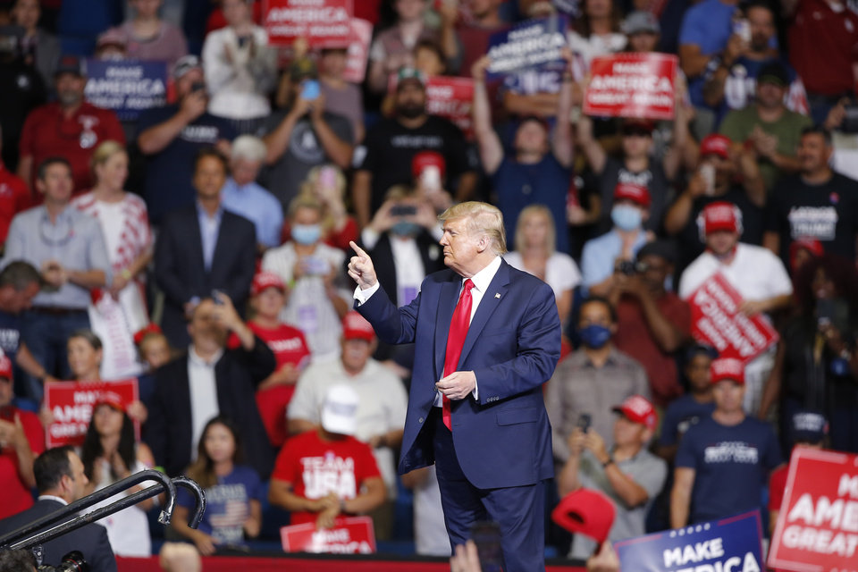 Photo - President Donald Trump points to the crowd following his speech during a rally at the BOK Center in Tulsa, Okla., Saturday, June 20, 2020. [Sarah Phipps/The Oklahoman]