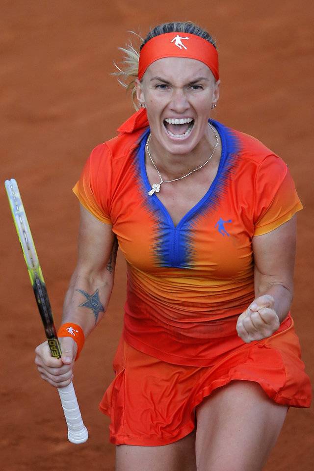 Photo - Russia's Svetlana Kuznetsova celebrates winning the fourth round match of the French Open tennis tournament against Lucie Safarova of the Czech Republic at the Roland Garros stadium, in Paris, France, Monday, June 2, 2014. Kuznetsova won in two sets 6-3, 6-4. (AP Photo/Michel Spingler)