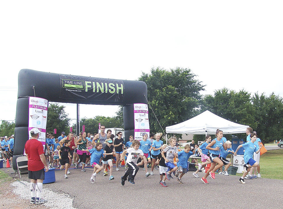Photo - The younger kids attending Riley's Run were excited to show off their racing skills in a 1-mile fun run.