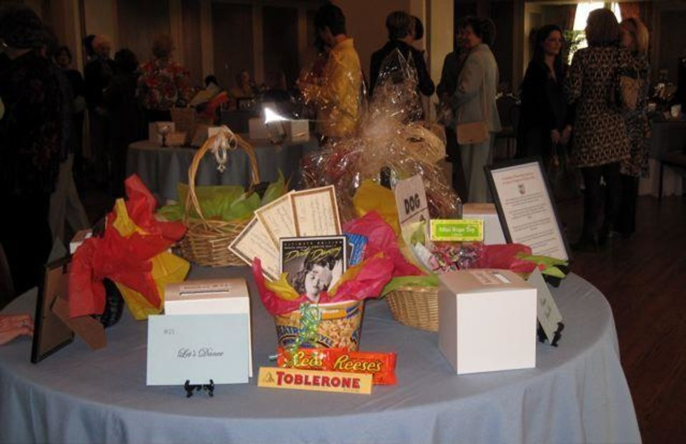 GATHERING OF ANGELS.....Tables were set at the Oklahoma City Golf and  Country Club with raffle items. (Photo by Helen Ford Wallace).