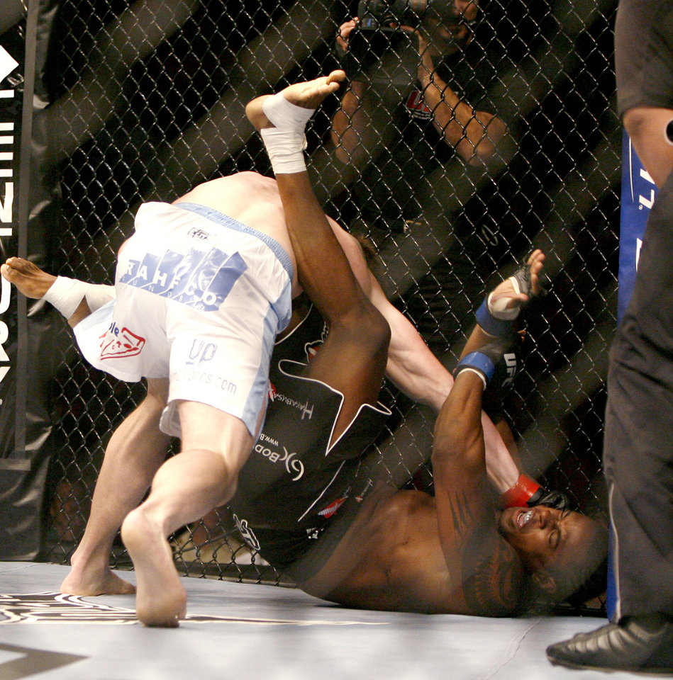 Photo - CB Dollaway, left, punches Jay Silva   during UFC Fight Night at the Cox Convention Center in Oklahoma City, Wednesday, September 16, 2009.  Photo by Bryan Terry, The Oklahoman