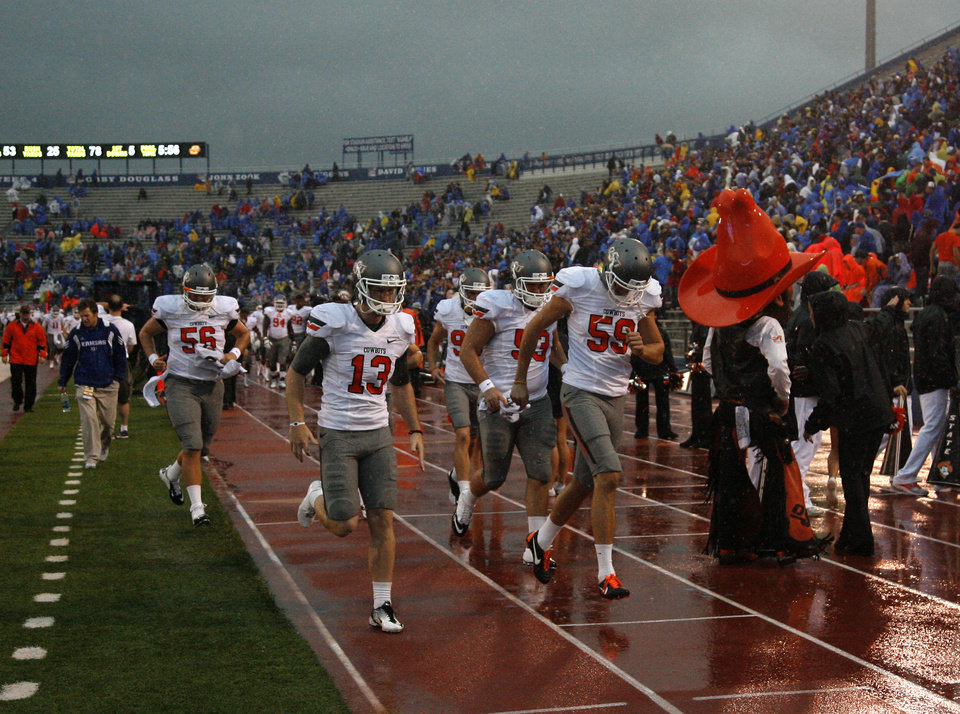 OSU leaves the field during a rain delay at the college football game between Oklahoma State University (OSU) and the University of Kansas (KU) at Memorial Stadium in Lawrence, Kan., Saturday, Oct. 13, 2012. Photo by Sarah Phipps, The Oklahoman