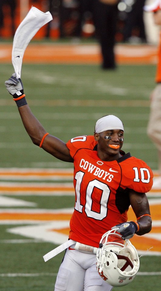 OSU's Tommy Devereaux celebrates following the college football game between the Oklahoma State University Cowboys (OSU) and the Texas Tech University Red Raiders (TTU) at Boone Pickens Stadium  on Saturday, Sept. 22, 2007, in Stillwater, Okla. 