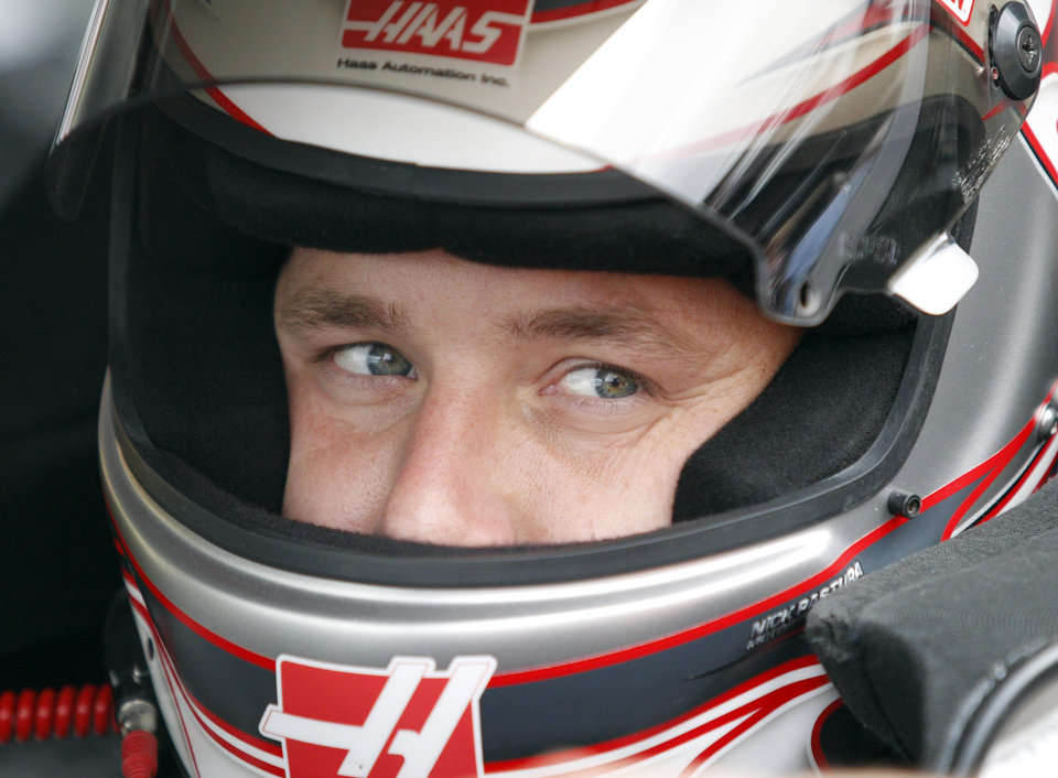 Driver Ryan Newman looks out from his car during practice for Sunday's NASCAR Sylvania 300 auto race at New Hampshire Motor Speedway, Friday, Sept. 23, 2011, in Loudon, N.H. (AP Photo/Mary Schwalm)