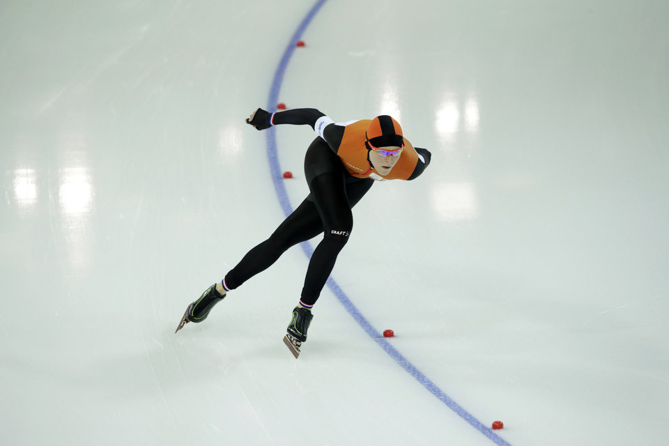 Photo - Jorien ter Mors of the Netherlands skates her way to set a new Olympic record in the women's 1,500-meter race at the Adler Arena Skating Center during the 2014 Winter Olympics in Sochi, Russia, Sunday, Feb. 16, 2014. (AP Photo/Matt Dunham)