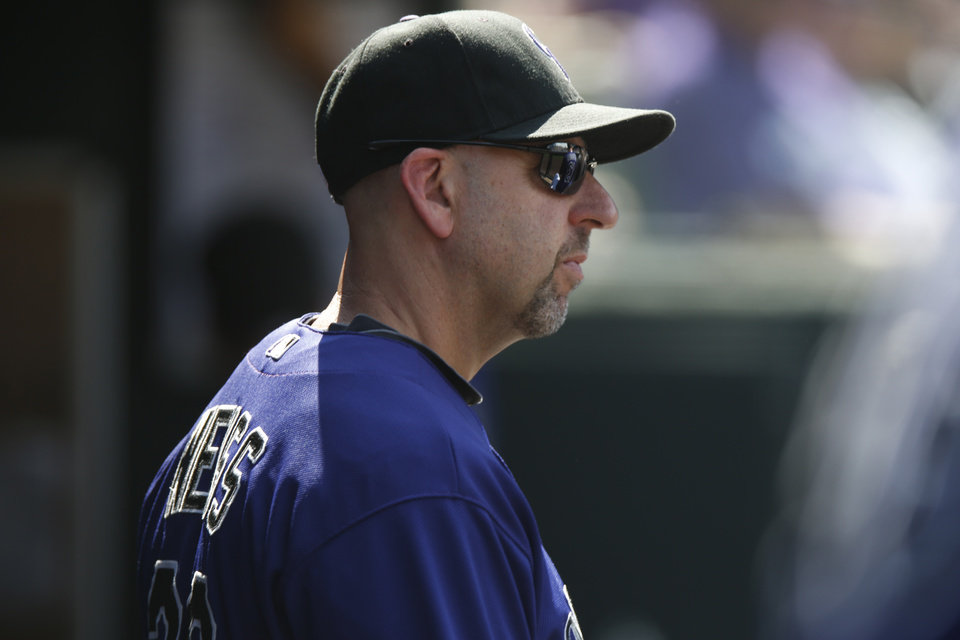 Photo - Colorado Rockies manager Walt Weiss looks on against the San Francisco Giants in the seventh inning of the Giants' 4-2 victory in a baseball game in Denver on Monday, Sept. 1, 2014. The game was resumed in the bottom of the sixth inning of play when it was suspended because of rain on May 22. (AP Photo/David Zalubowski)