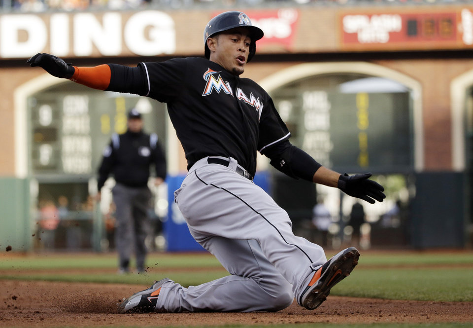 Photo - Miami Marlins' Giancarlo Stanton slides into third base with a triple during the third inning of a baseball game against the San Francisco Giants on Saturday, May 17, 2014, in San Francisco. (AP Photo/Marcio Jose Sanchez)