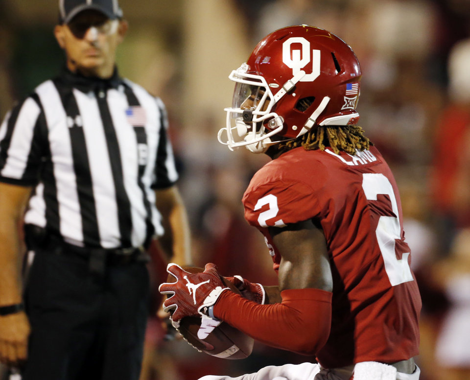 Photo - Oklahoma's CeeDee Lamb (2) scores in overtime during a college football game in which the University of Oklahoma Sooners (OU) defeated the Army Black Knights 28-21 at Gaylord Family-Oklahoma Memorial Stadium in Norman, Okla., on Saturday, Sept. 22, 2018. Photo by Steve Sisney, The Oklahoman