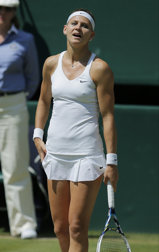 Photo - Lucie Safarova of Czech Republic reacts after losing a point to Petra Kvitova of Czech Republic during their women's singles semifinal match at the All England Lawn Tennis Championships in Wimbledon, London, Thursday, July 3, 2014. (AP Photo/Pavel Golovkin)