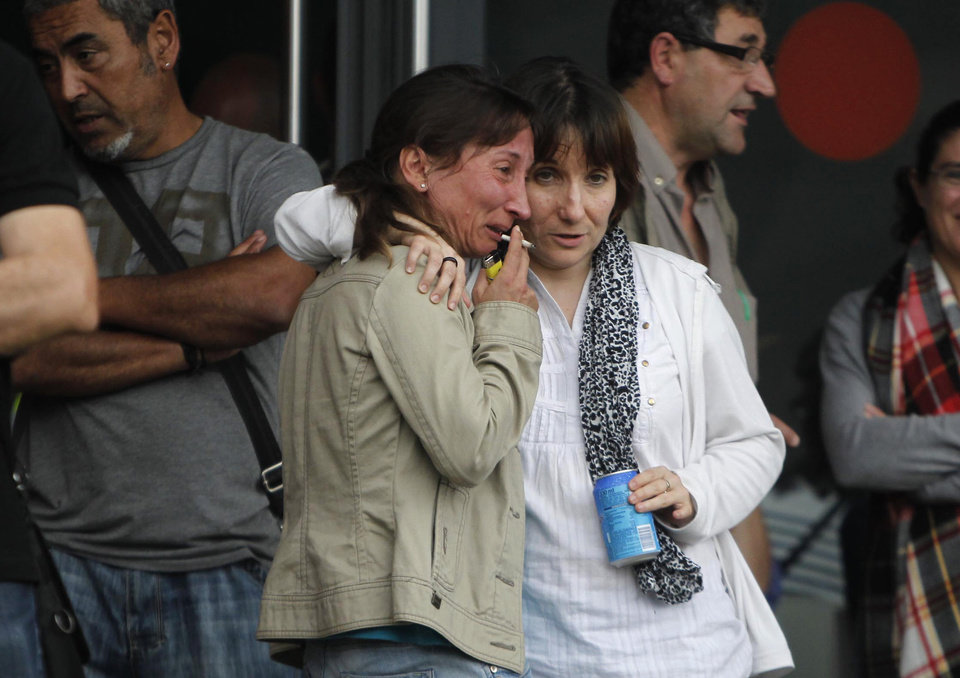 Photo - Relatives of victims involved in a train accident wait for news at a victims information point in Santiago de Compostela, Spain, on Thursday July 25, 2013. The death toll in a passenger train crash in northwestern Spain rose to 77 on Thursday after the train jumped the tracks on a curvy stretch just before arriving in the northwestern shrine city of Santiago de Compostela, a judicial official said. (AP Photo/Salome Montes)