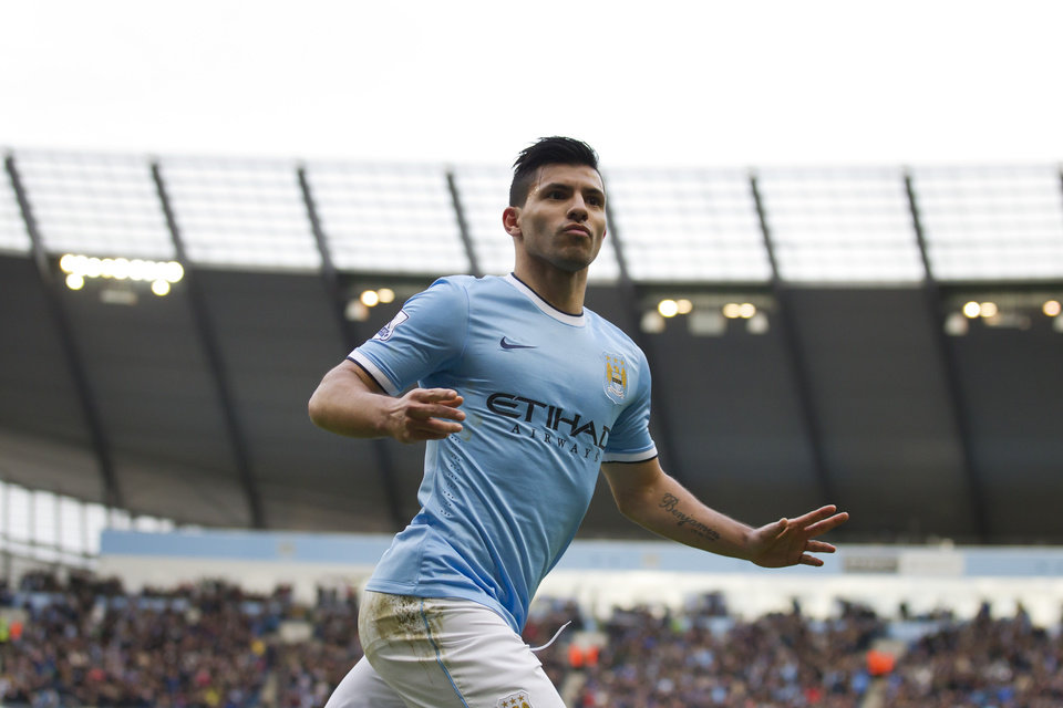 Manchester City's Sergio Aguero celebrates after scoring against Arsenal during their English Premier League soccer match at the Etihad Stadium, Manchester, England, Saturday Dec. 14, 2013. (AP Photo/Jon Super)