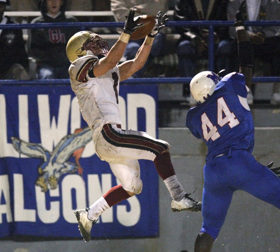 Photo - Lincoln Christians Zack Simmons catches a pass in front of Millwood's Larry Lambeth during a Class 2A high school football playoff game between Millwood and Lincoln Christian in Oklahoma City, Friday, Nov. 25, 2011. Photo by Bryan Terry, The Oklahoman