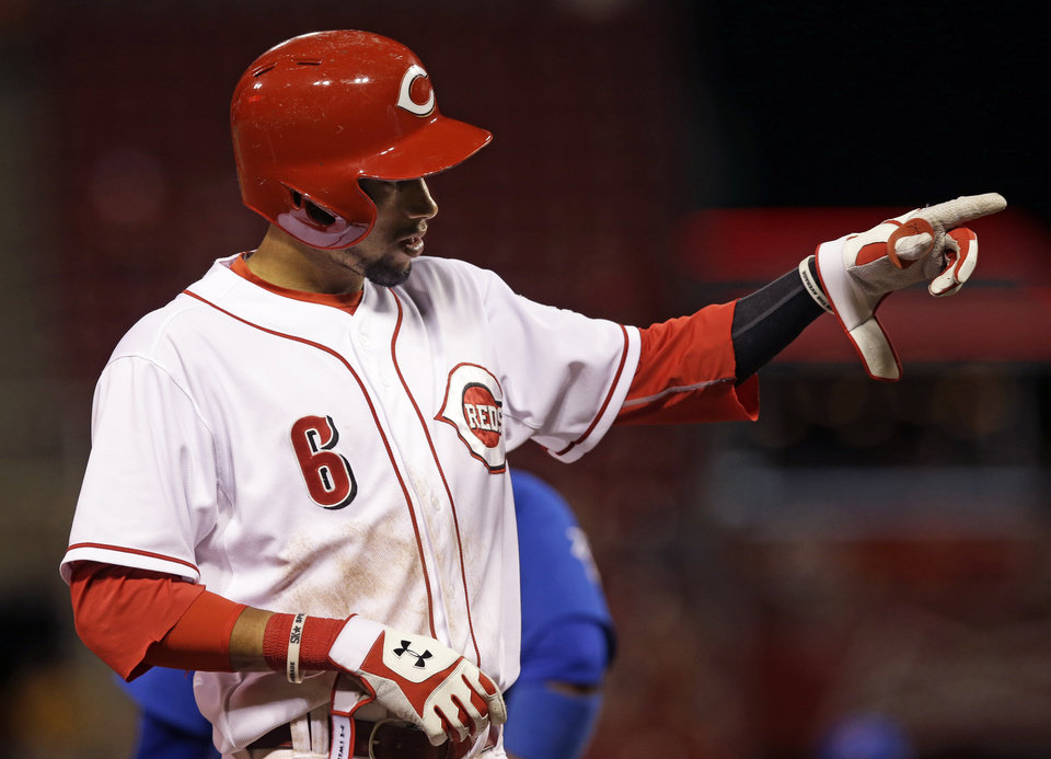 Photo - Cincinnati Reds' Billy Hamilton points to the dugout after hitting a triple to drive in three runs in the eighth inning of a baseball game against the Chicago Cubs, Monday, July 7, 2014, in Cincinnati. Cincinnati won 9-3. (AP Photo/Al Behrman)