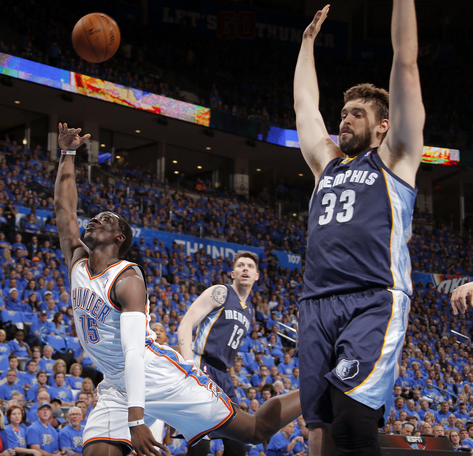 Photo - Oklahoma City's Reggie Jackson (15) throws up a shot beside Memphis' Marc Gasol (33) during Game 1 in the first round of the NBA playoffs between the Oklahoma City Thunder and the Memphis Grizzlies at Chesapeake Energy Arena in Oklahoma City, Saturday, April 19, 2014. Photo by Sarah Phipps, The Oklahoman