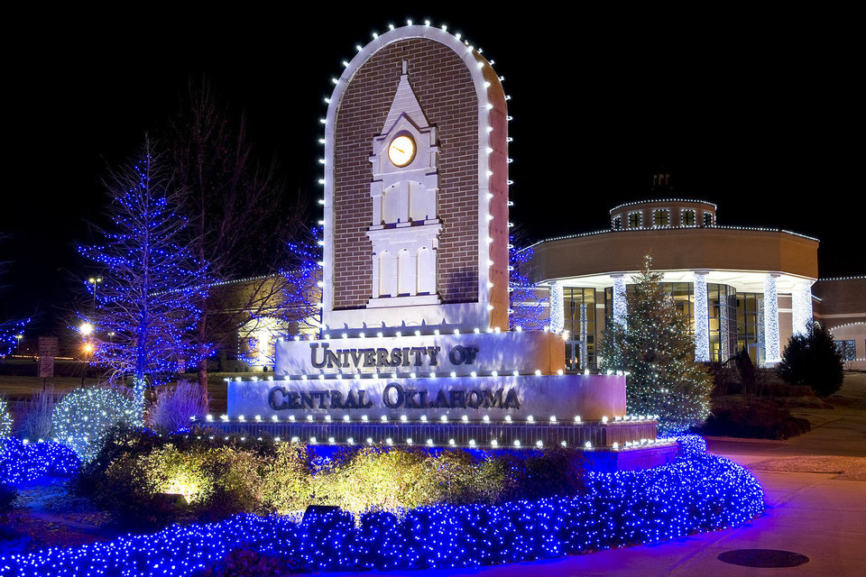 Photo - The entrance to the University of Central Oklahoma, decorated with Christmas lights. The lights on campus will be turned on during the Dec. 6 WinterGlow. PHOTO PROVIDED.  UCO photo by Daniel Smith. - PHOTO PROVIDED