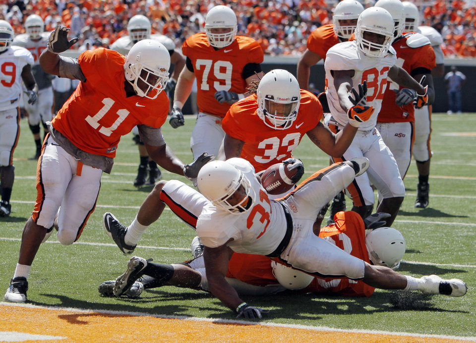 OSU's Jeremy Smith (31) rushes for a touchdown in front of Shaun Lewis (11), Andrew Smith (79), LeRon Furr (33) and Isaiah Anderson (82) during the Orange/White spring football game for the Oklahoma State University Cowboys at Boone Pickens Stadium in Stillwater, Okla., Saturday, April 16, 2011. Photo by Nate Billings, The Oklahoman