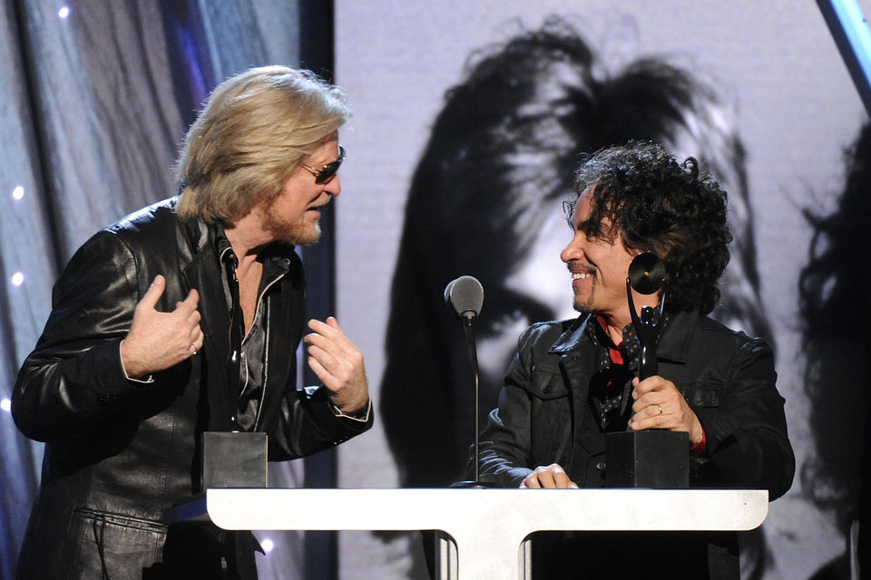 Photo - Hall of Fame Inductees, Hall and Oates, Daryl Hall and John Oates speak at the 2014 Rock and Roll Hall of Fame Induction Ceremony on Thursday, April, 10, 2014 in New York. (Photo by Charles Sykes/Invision/AP)