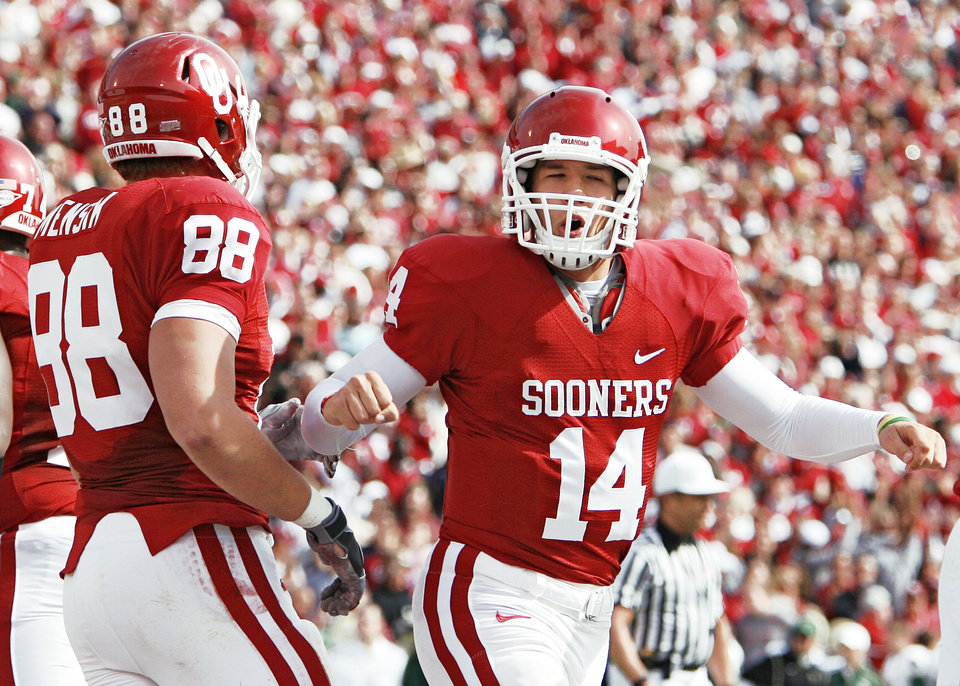 Photo - Sam Bradford, right, celebrates OU's first touchdown against Baylor on Saturday in Norman. Bradford had a 389-yard passing performance in his return to action.  Photo by Chris Landsberger, The Oklahoman