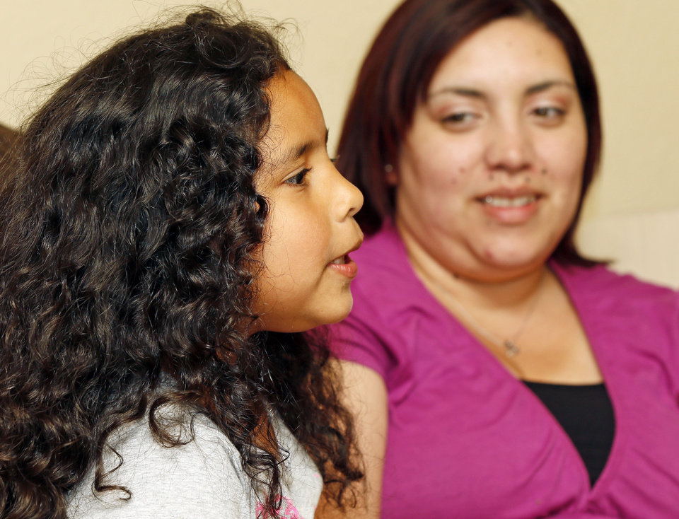Photo - Kaylee Sanchez, 6, speaks during an interview as her mother Maria Sanchez watches at their home in the Plaza Towers neighborhood in Moore. Photo by Nate Billings, The Oklahoman   NATE BILLINGS - NATE BILLINGS