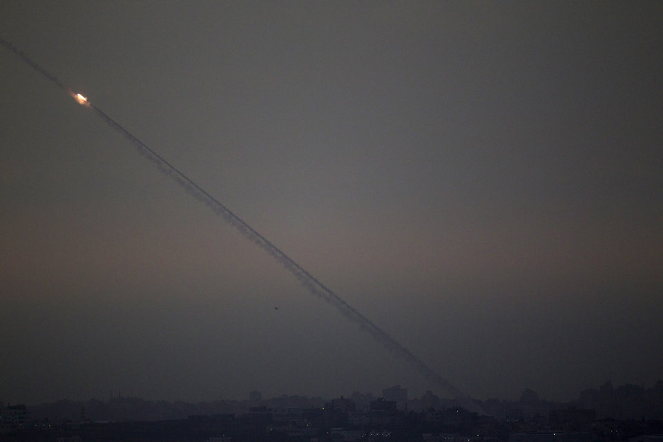 Photo -   Rockets lunched by Palestinian militants towards Israel make their way from the northern Gaza Strip, as seen from the Israel Gaza Border, southern Israel, Saturday, Nov. 17, 2012. The Israeli military says its