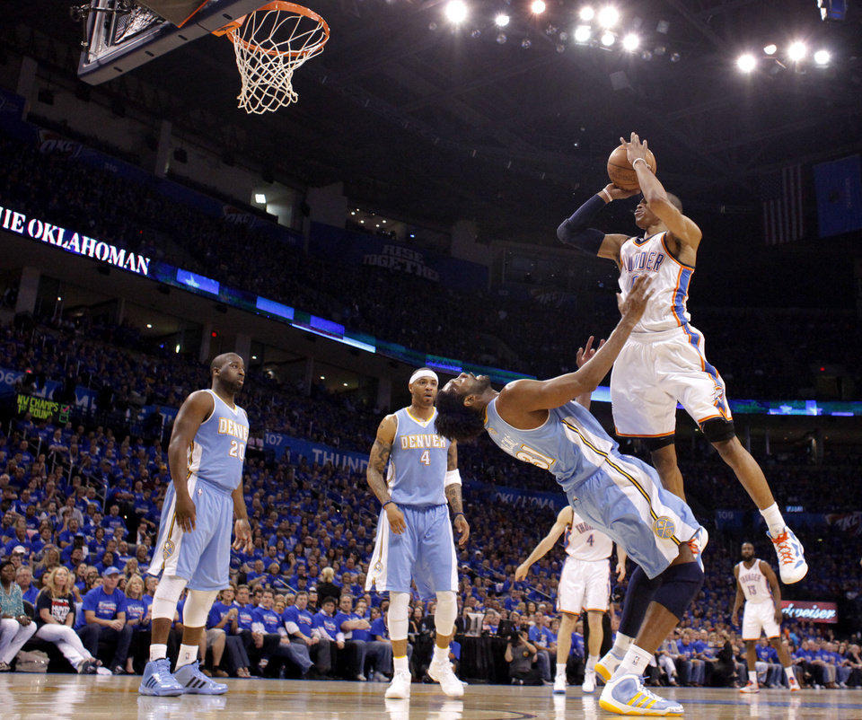 Photo - Oklahoma City's Russell Westbrook (0) is fouled by Denver's Nene (31) as  Raymond Felton (20) and Kenyon Martin (4) watch during the first round NBA playoff game between the Oklahoma City Thunder and the Denver Nuggets on Sunday, April 17, 2011, in Oklahoma City, Okla. Photo by Chris Landsberger, The Oklahoman