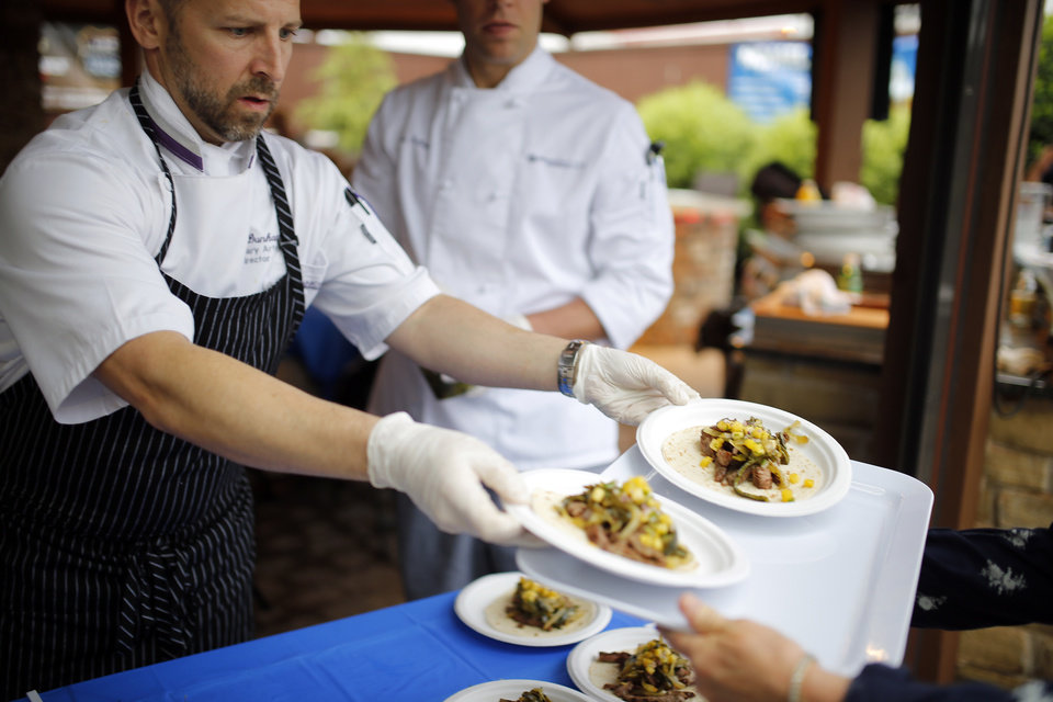 Photo - Marc Dunham of the School of Culinary Arts at Francis Tuttle hands out his Texas fajitas during Open Flame, Thursday April 23, 2105, in Oklahoma City.  Photo by Sarah Phipps, The Oklahoman