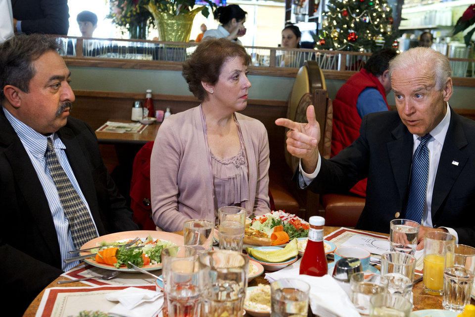 Vice President Joe Biden points toward Fernando Garavito of North Potomac, Md., left, as he has lunch with Garavito and Anne Marie Munos of Falls Church, Va., center, Friday, Dec. 7, 2012, at the Metro 29 diner in Arlington, Va. (AP Photo/Jacquelyn Martin)
