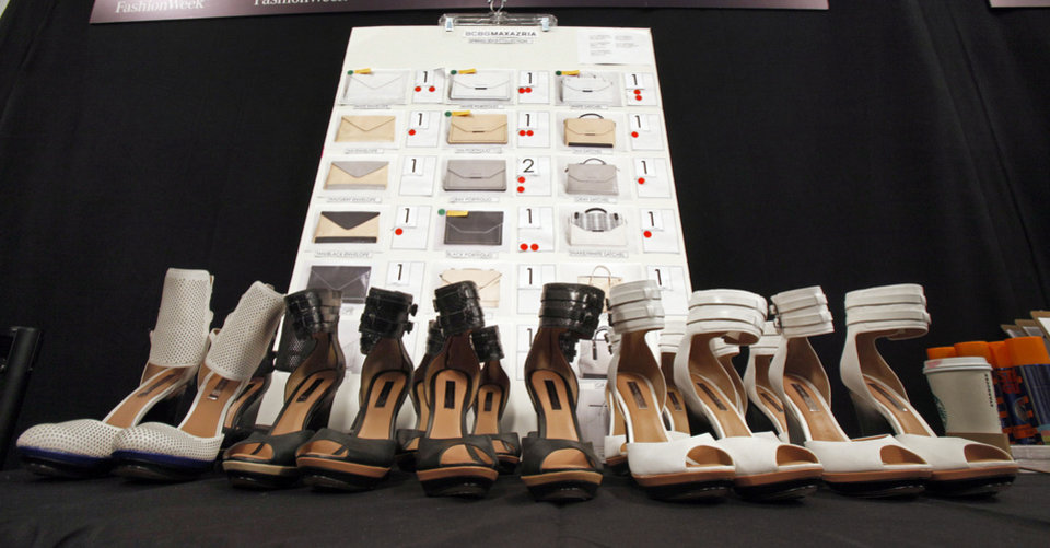 Photo -   Shoes are lined-up on a table backstage before the BCBG MAX AZRIA Spring 2013 collection is modeled during Fashion Week in New York, Thursday, Sept. 6, 2012. (AP Photo/Richard Drew)