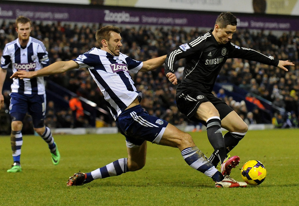 Photo - West Brom's Gareth McAuley, left, competes for the ball with Chelsea's  Fernando Torres during the English Premier League soccer match between West Bromwich Albion and Chelsea at The Hawthorns Stadium in West Bromwich, England, Tuesday, Feb. 11, 2014.  (AP Photo/Rui Vieira)