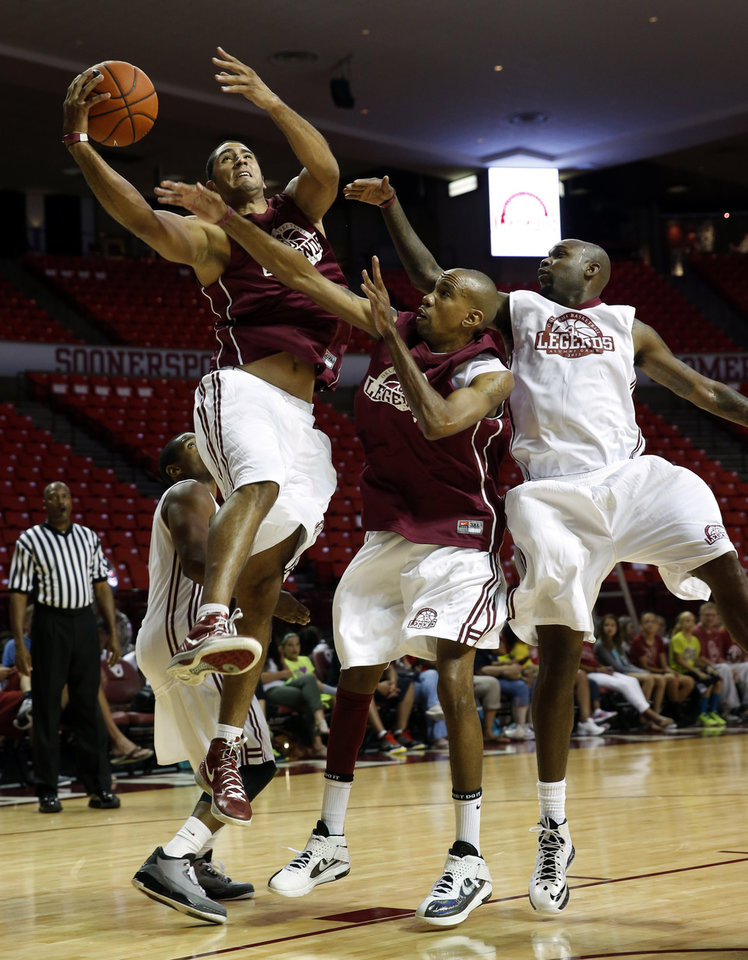 C. J. Washington shoots guarded by Chris Black and Ebi Ere as the University of Oklahoma Sooners (OU) basketball alumni play at The Lloyd Noble Center on Saturday, Aug. 24, 2013 in Norman, Okla. Photo by Steve Sisney, The Oklahoman