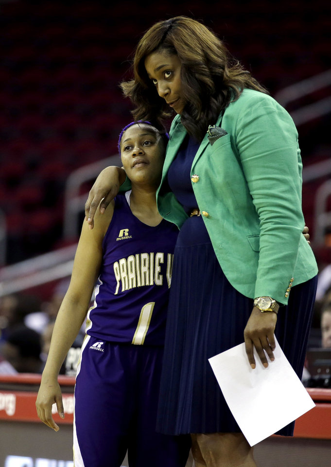 Photo - Prairie View A&M's Jeanette Jackson (1) gets a hug from her coach Dawn Brown after leaving the game during the closing minutes of the second half of an NCCA college basketball game against Southern in the semifinals of the Southwestern Athletic Conference tournament Friday, March 14, 2014, in Houston. Prairie View A&M won 72-43. (AP Photo/David J. Phillip)