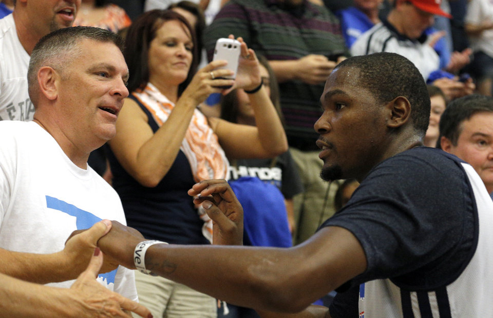 Photo - Oklahoma City's Kevin Durant (35) greets fans following the Oklahoma City Thunder's  Blue and White scrimmage at Westmoore High School in Moore, Okla., Sunday, Oct. 13, 2013. Photo by Sarah Phipps, The Oklahoman