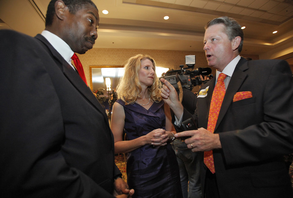 Photo - Republican labor Commissioner Mark Costello, right talks with Cindy Lankford and Harold Roberts at the republican Watch Party at the Marriott on Tuesday, Nov. 2, 2010, in Oklahoma City, Okla.   Photo by Chris Landsberger, The Oklahoman