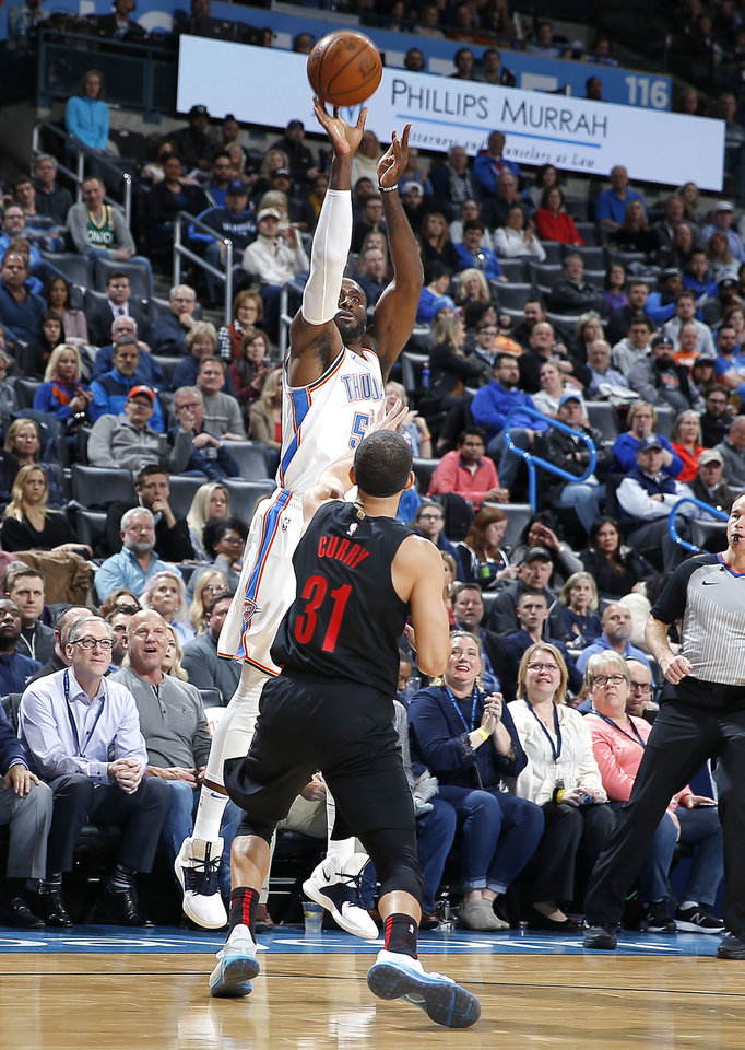 Photo - Oklahoma City's Patrick Patterson (54) shoots a 3-point basket over Portland's Seth Curry (31) during the NBA basketball game between the Oklahoma City Thunder and the Portland Trail Blazers at Chesapeake Energy Arena in Oklahoma City, Tuesday, Jan. 22, 2019. Photo by Sarah Phipps, The Oklahoman