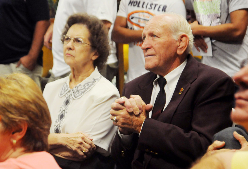 Photo - Wrestling legend, Dan Hodge and his wife wait as the International Olympic Committee vote on the provisional sport to be in the 2020 Olympics.  The National Wrestling Hall of Fame held a watch party for the IOC's meeting on Sunday Sep. 8 2013. Photo by Jackie Dobson, for The Oklahoman