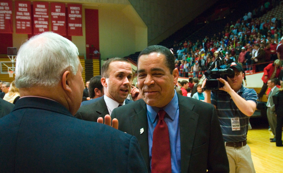 Photo - Kelvin Sampson (right) greets Eric Behrman after being introduced as Indiana University's new college basketball head coach Wednesday.  Sampson is the former University of Oklahoma (OU) coach, and replaces Mike Davis. Several hundred fans also attended the press conference at Assembly Hall. By David Snodgress, Herald-Times.
