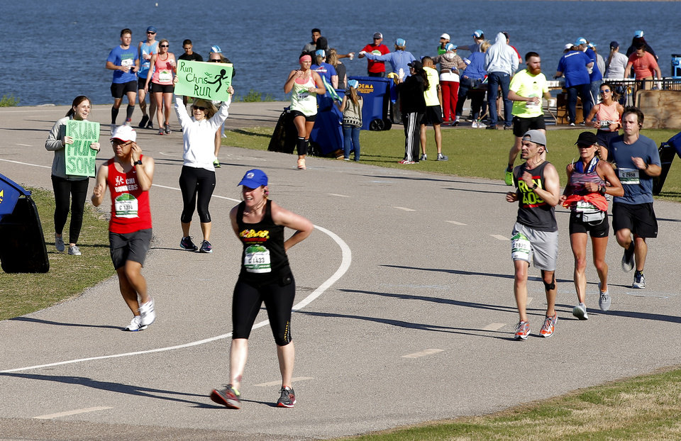Photo - Spectators cheer as runners make their way around Lake Hefner during the Oklahoma City Memorial Marathon in Oklahoma City, Sunday, April 29, 2018. Photo by Bryan Terry, The Oklahoman
