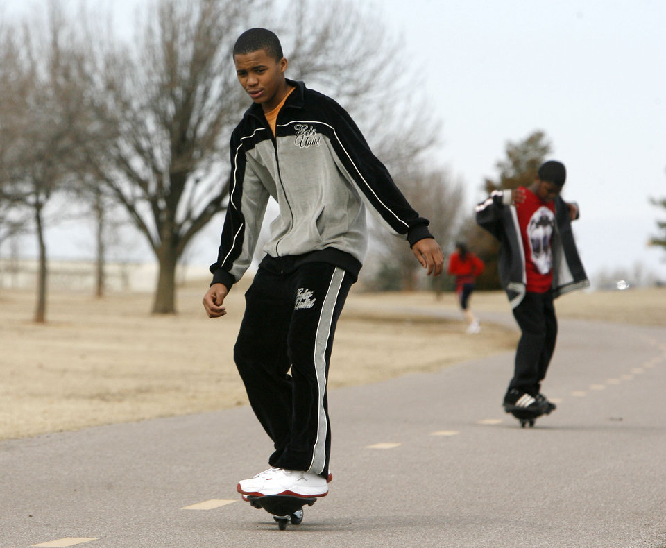 Keoreon Jones, 11, and his brother Kierre, 11, take advantage of 70 degree weather to ride their skateboards at Lake Hefner in Oklahoma City, OK, Monday, Feb. 25, 2008. BY PAUL HELLSTERN, THE OKLAHOMAN