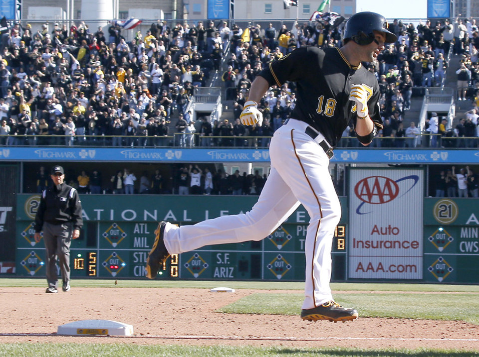 Photo - Pittsburgh Pirates' Neil Walker (18) rounds third after hitting the game winning home run in the tenth inning of an opening day baseball game against the Chicago Cubs on Monday, March 31, 2014, in Pittsburgh. The Pirates won 1-0 in ten innings. (AP Photo/Keith Srakocic)