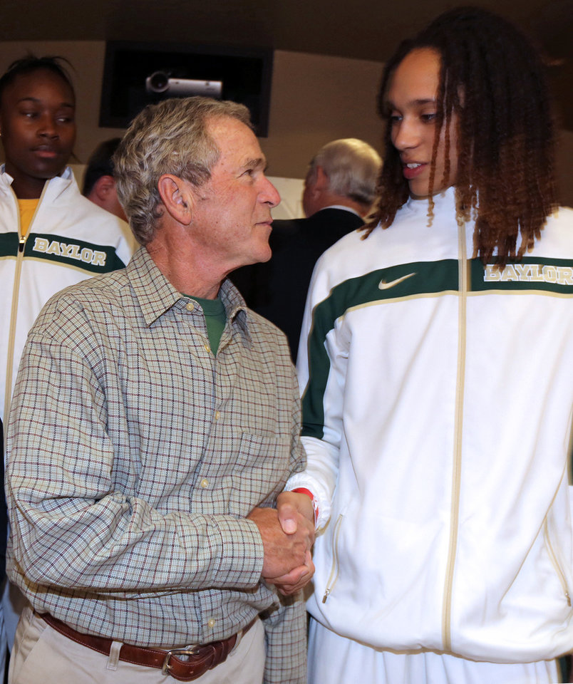 Former President George W. Bush meets with Baylor center Brittney Griner, right, before their second-round game against Florida State in the NCAA women's college basketball tournament, Tuesday, March 26, 2013, in Waco, Texas. (AP Photo/Robert Rogers, Pool)