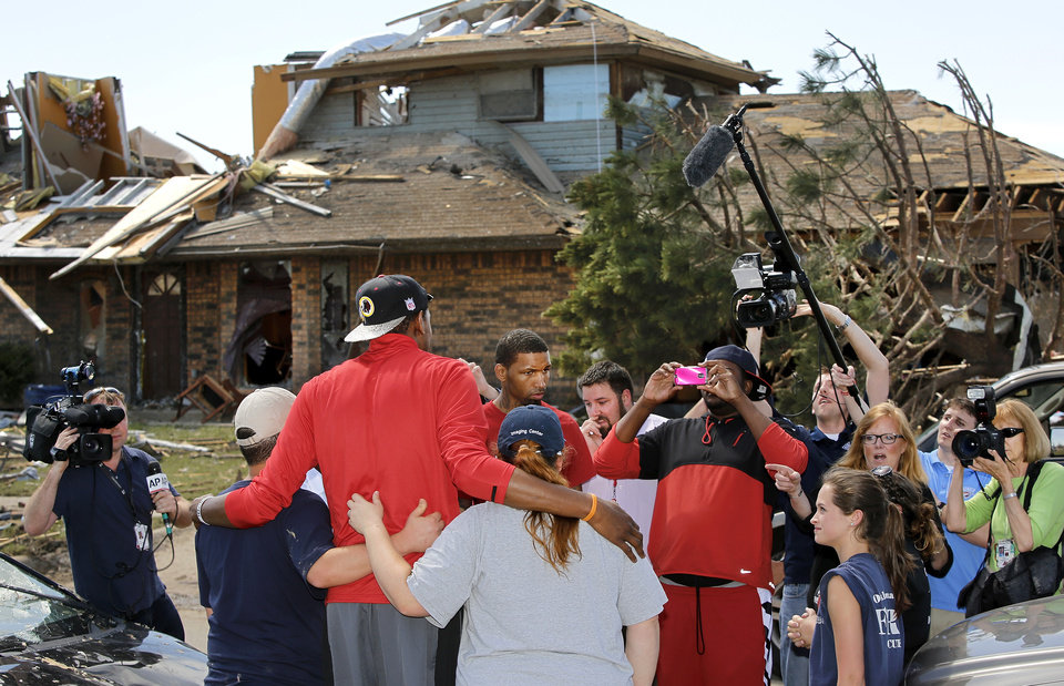 Photo - Oklahoma City Thunder's Kevin Durant toured a southwest Oklahoma City neighborhood that took a direct hit in last Monday's F5 tornado to offer words of support and encouragement to homeowners and volunteers assisting with the relief effort. Durant walked several blocks along S. Hudson, near SW 145, on Wednesday afternoon, May 22, 2013, and also visited Briarwood School, the heavily damaged elementary school in the same neighborhood.     Photo  by Jim Beckel, The Oklahoman.
