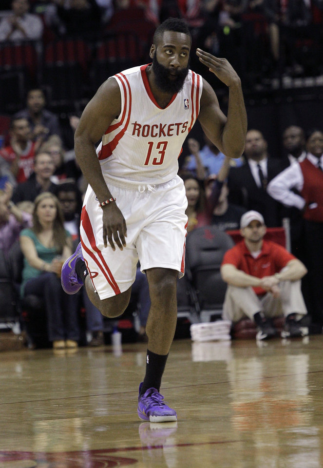 Photo - Houston Rockets guard James Harden (13) motions after hitting a three-point shot against the Portland Trail Blazers during the first half of an NBA basketball game, Monday, Jan. 20, 2014, in Houston. (AP Photo/Bob Levey)