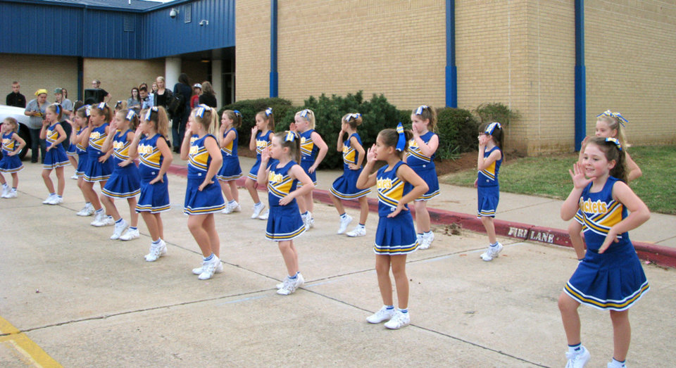 Elementary school cheerleaders from the Choctaw-Nicoma Park School District perform a number during the Choctaw High School Homecoming Festival.