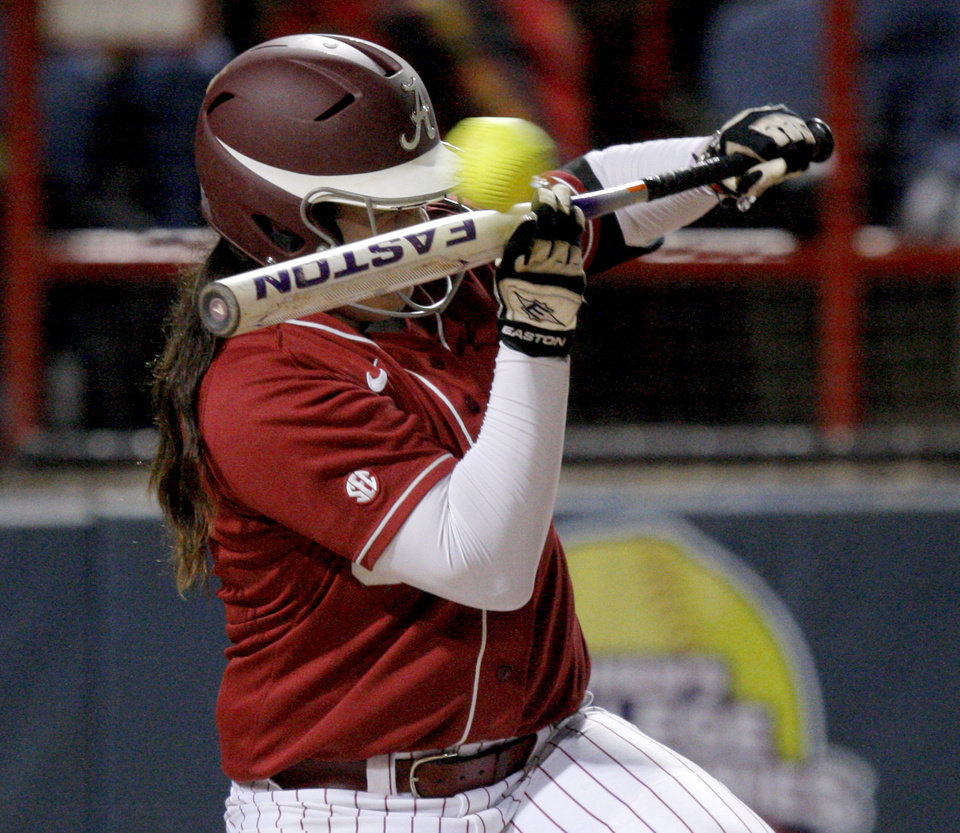 Alabama\'s Jackie Traina tries for the bunt in the fourth inning during a Women\'s College World Series game against Arizona State at ASA Hall of Fame Stadium in Oklahoma City, Friday, June 1, 2012. Photo by Bryan Terry, The Oklahoman