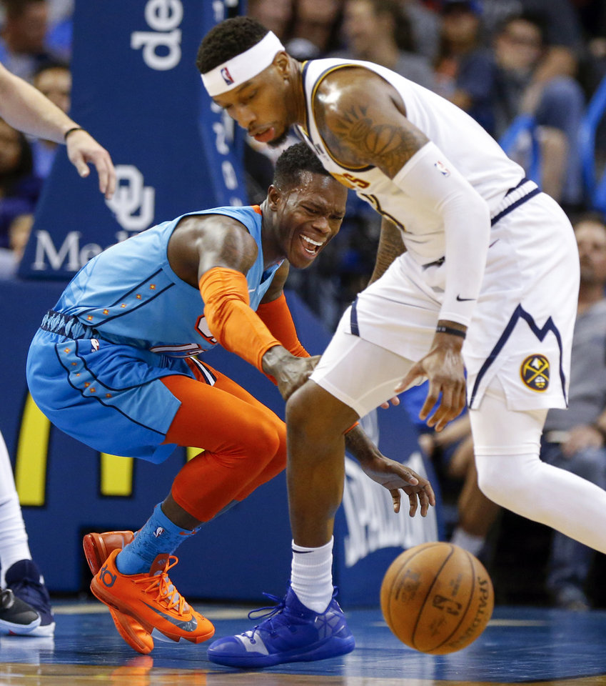 Photo - Oklahoma City's Dennis Schroder (17), left, turns the ball over next to Denver's Torrey Craig (3) in the fourth quarter during an NBA basketball game between the Denver Nuggets and the Oklahoma City Thunder at Chesapeake Energy Arena in Oklahoma City, Friday, March 29, 2019. Denver won 115-105. Photo by Nate Billings, The Oklahoman