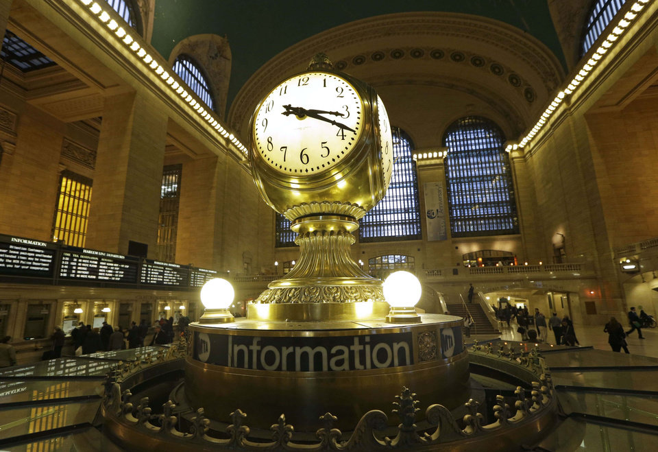 Photo - FILE- In this Jan. 9, 2013 file photo, the famous opalescent clock keeps time at the center of the main concourse in Grand Central Terminal is shown in New York.  The country's most famous train station and one of its finest examples of Beaux Arts architecture in America turns 100 on Feb. 1.  The building's centennial comes 15 years after a triumphant renovation that  removed decades of grime and decay. (AP Photo/Kathy Willens, File)