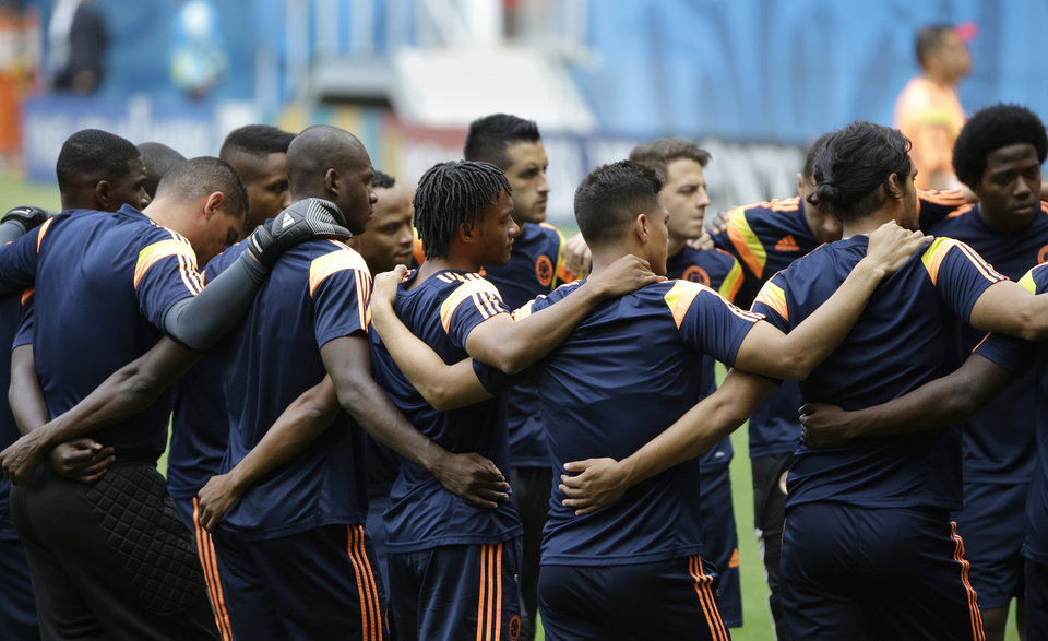 Photo - Members of the Colombia soccer squad huddle in prayer during a training session at the Estadio Nacional in Brasilia, Brazil, Wednesday, June 18, 2014. Colombia will play in group C in the Brazil 2014 soccer World Cup. (AP Photo/Sergei Grits)