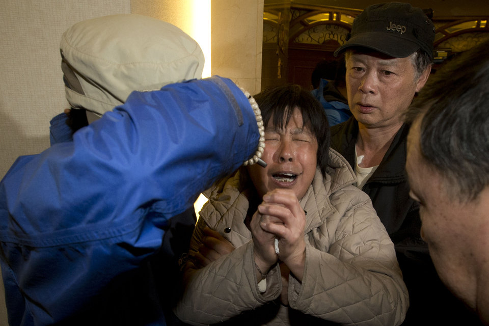 Photo - A relative of Chinese passengers aboard the Malaysia Airlines MH370, cries after being told the latest update in Beijing, China, Monday, March 24, 2014. A new analysis of satellite data indicates the missing Malaysia Airlines plane crashed into a remote corner of the Indian Ocean, Malaysian Prime Minister Najib Razak said Monday. The news is a major breakthrough in the unprecedented two-week struggle to find out what happened to Flight 370, which disappeared shortly after takeoff from Kuala Lumpur to Beijing with 239 passengers and crew aboard on March 8. (AP Photo/Ng Han Guan)