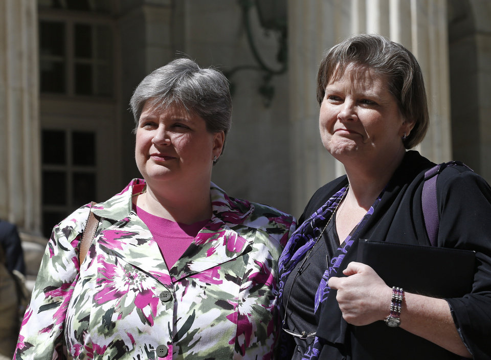 Photo -                    Sharon Baldwin, left, and her partner Mary Bishop, who are challenging Oklahoma's ban on same-sex marriage, leave court Thursday following a hearing at the 10th U.S. Circuit Court of Appeals in Denver.                                        AP PHOTO